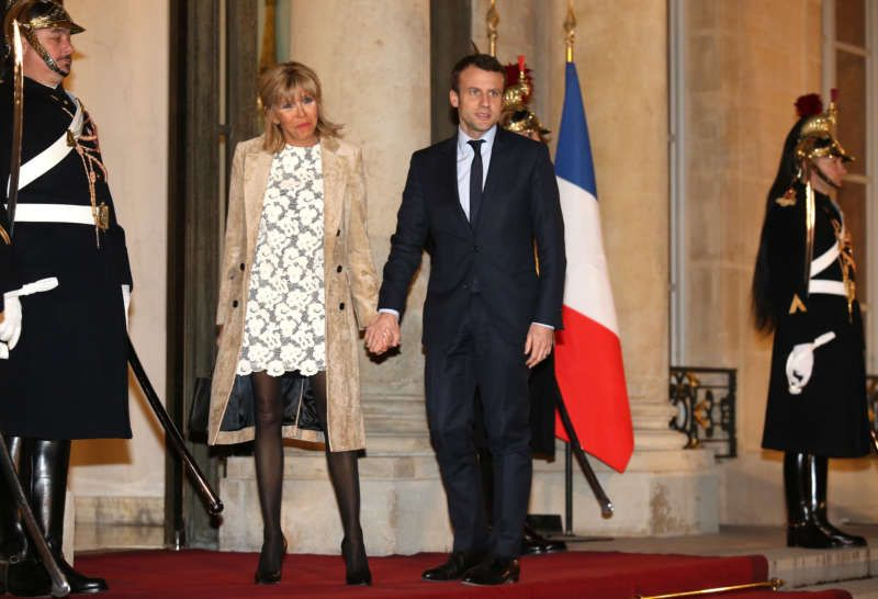 The French presidential candidate Emmanuel Macron and his wife, Brigitte Trogneux, arriving at a state dinner last March. Jean Catuffe/Getty Images