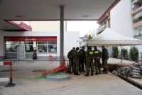 Military personnel at the site of a World War II bomb found during excavation works at a gas station in Thessaloniki, Greece, this month. Alexandros Avramidis/Reuters