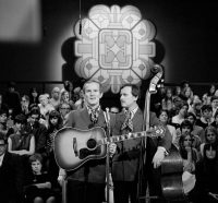 "Tom, left, and Dick Smothers on ""The Smothers Brothers Comedy Hour."" CBS, via Getty Images"
