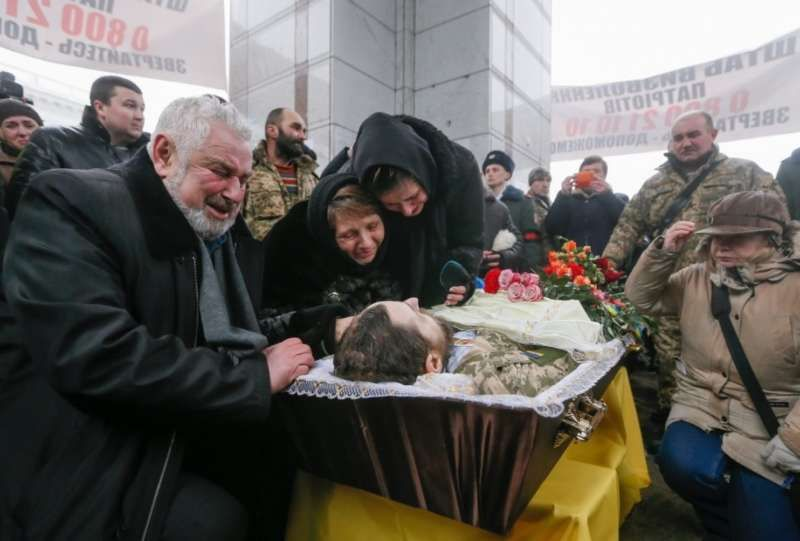 Friends and family members mourn a soldier killed in fighting between government troops and Russia-backed separatist rebels near the town of Avdiivka earlier this week. (Sergey Dolzhenko/European Pressphoto Agency)