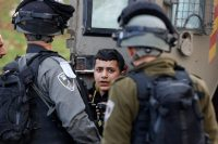 Israeli border police officers arresting a Palestinian boy during clashes after the killing of a Palestinian militant by Israeli forces last month. Credit Majdi Mohammed/Associated Press