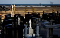 Gravestones photographed on Feb. 28 stand near a Namie, Japan, seaside devastated by the March 11, 2011, tsunami, which crippled the nearby Fukushima Daiichi nuclear power plant. (Toru Hanai/Reuters)