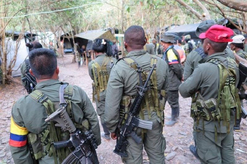 FARC fighters wait for a meeting to discuss who will be on guard that night in Cauca, Colombia. CRISIS GROUP/Kyle Johnson
