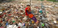A Bangladeshi girl plays on a swing, in Dhaka, Bangladesh, December 27, 2016. REUTERS/Mohammad Ponir Hossain TPX IMAGES OF THE DAY - RTX2WLHK