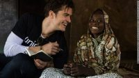 UNICEF Goodwill Ambassador Orlando Bloom (left) smiles as he speaks with twelve-year-old Eta Ibrahim at her family's home, where she lives with her father - the village chief, and her four siblings, in Bosso, Niger, Sunday 19 February 2017.