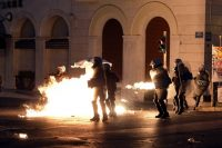A protester clashes with riot police in front of the Greek Parliament in Athens in July 2015. (Milos Bicanski/Getty Images)