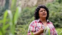 Berta Caceres, who was murdered, at the banks of the Gualcarque River in the Rio Blanco region of western Honduras where she, COPINH (the Council of Popular and Indigenous Organizations of Honduras) and the people of Rio Blanco maintained a struggle to halt construction on the Agua Zarca Hydroelectric project, saying that it poses grave threats to local environment, river and indigenous Lenca people. Tim Russo Tim Russ0