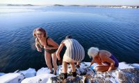 People prepare for a swim in the Oslo fjord. Photograph: Aas, Erlend/AFP/Getty Images