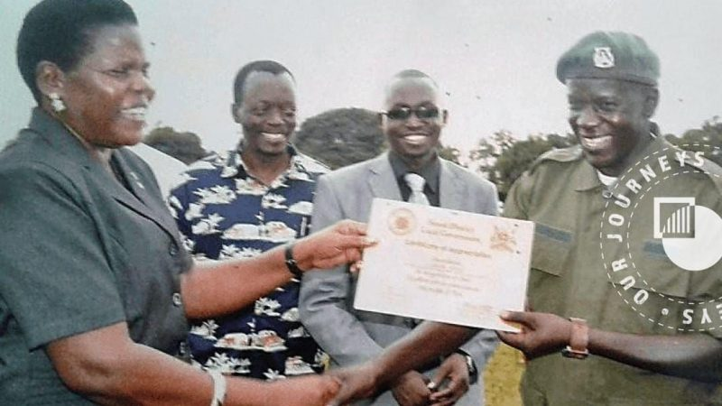 A photo taken as a Certificate of Appreciation is presented for services rendered by the Arrow Boys during the LRA campaign at a ceremony in December 2004. CRISIS GROUP/Magnus Taylor
