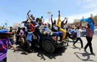 Civilians ride on a Somali police car as they celebrate the election of President Mohamed Abdullahi Mohamed in the streets of Somalia's capital, Mogadishu, on Feb. 9. (Feisal Omar/Reuters)