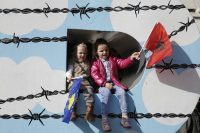 Children wave Albanian and Kosovar flags for Kosovo independence day, February 2016. Marko Djurica/Reuters