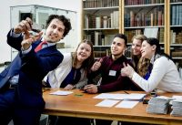 Dutch Green Party (Groen Links) leader Jesse Klaver, left, takes a selfie with campaign workers after casting his ballot at a polling station in The Hague. (Robin van Lonkhuijsen/Agence France-Presse via Getty Images)