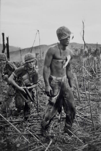A dazed soldier during the Battle of Hill 811, near Khe Sanh, South Vietnam, 1967.