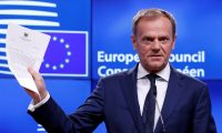 European council president Donald Tusk shows Theresa May's letter invoking article 50 of the EU's Lisbon treaty.