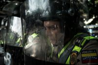 Police officers at an antigovernment protest in Caracas, Venezuela, in October. Meridith Kohut for The New York Times