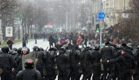 Police block the road during a demonstration in Minsk. Photo by Getty Images.