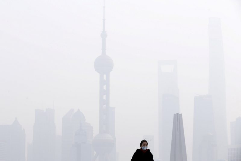 In front of the financial district of Pudong amid heavy smog in Shanghai in 2015. Credit Aly Song/Reuters