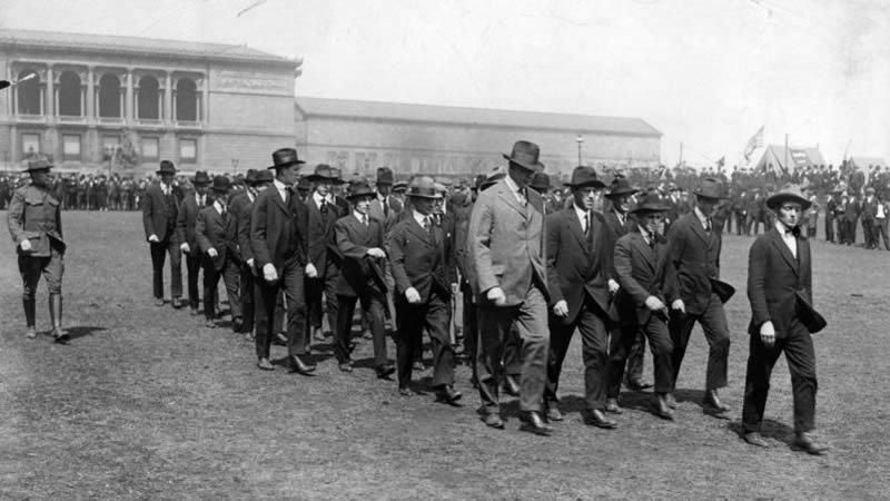 These 1917 rookies march in Grant Park with the Art Institute in the background. At hastily erected recruiting stations, civilians began their transformation into fighting men during World War I.