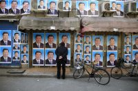 A building covered in posters of Chinese President Xi Jinping, Shanghai, China, March 26, 2016
