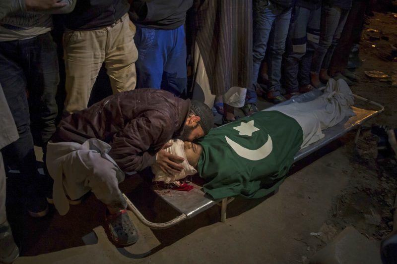 A Kashmiri man kissing the body of Shabir Ahmed, a teenage boy, during his funeral procession in Srinagar, Indian-controlled Kashmir, this month. Credit Dar Yasin/Associated Press