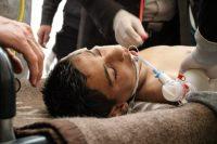 A Syrian victim receives treatment on April 4 at a field hospital in Saraqib, Syria. (European Pressphoto Agency)