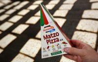 Manischewitz unveiled triangular matzo this year. Credit Seth Wenig / Associated Press