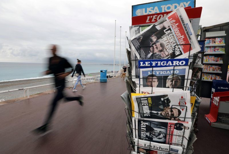 French newspapers with results from the presidential election on the Promenade Des Anglais in Nice, France, April 24, 2017