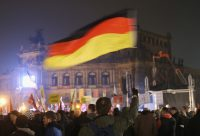 "A Pegida rally in Dresden, Germany, in 2015. The anti-immigrant movement uses the term ""das Abendland"" as a synonym for Western Europe and its values. Credit Sean Gallup/Getty Images"