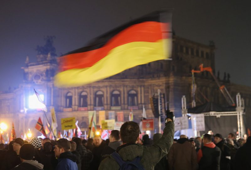 """A Pegida rally in Dresden, Germany, in 2015. The anti-immigrant movement uses the term """"das Abendland"""" as a synonym for Western Europe and its values. Credit Sean Gallup/Getty Images"""
