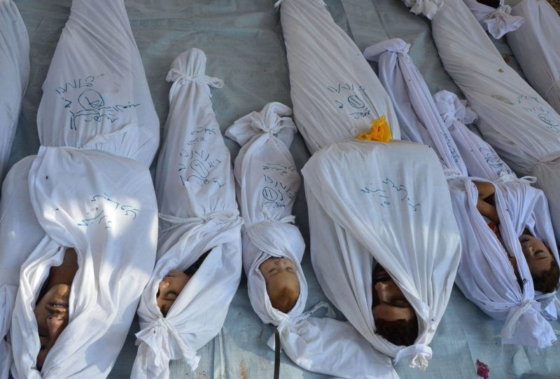 The bodies of people who Syrian rebels said were killed in a chemical weapons attack by government forces on Aug. 21, 2013. Credit Bassam Khabieh/Reuters