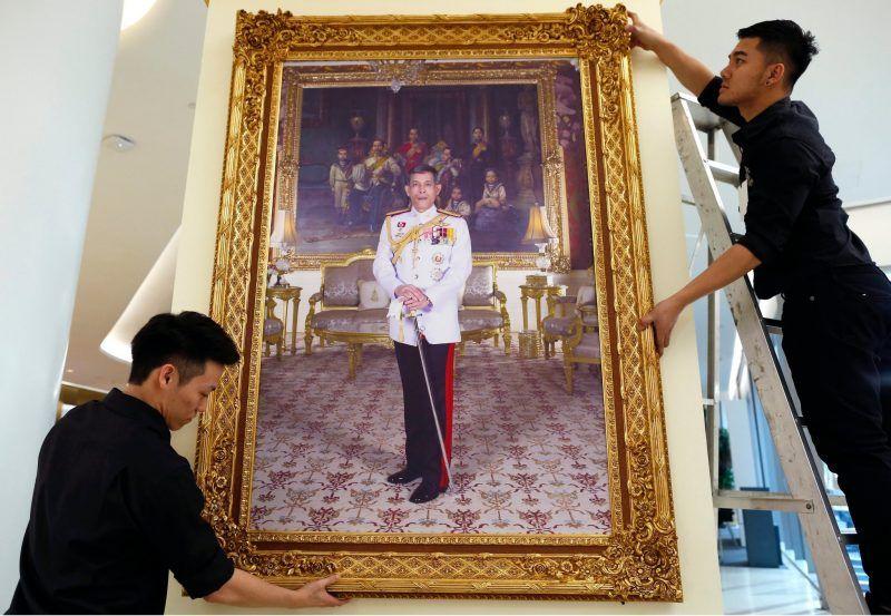 Thai workers installing a framed photograph of King Maha Vajiralongkorn at a shopping mall last December in Bangkok. Credit Rungroj Yongrit/European Pressphoto Agency