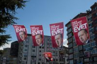 """""""EVET"""" (Yes) campaign banners showing the portrait of President Recep Tayyip Erdogan this month in Rize, Turkey. Credit Chris Mcgrath/Getty Images"""