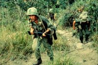 Soldiers moving through rough terrain searching for Viet Cong near Tuy Hoa, during Operation Harrison in 1966.