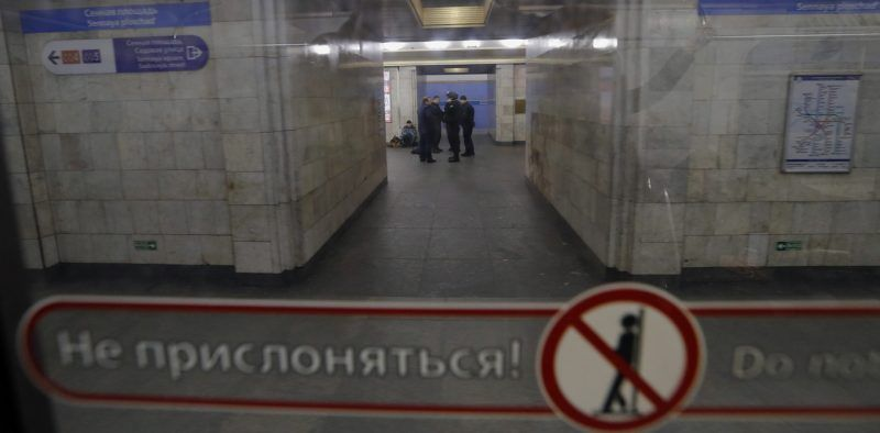 Police officers with a dog are seen through a train carriage window at the Sennaya Ploshchad metro station which is closed due to an anonymous bomb threat in Saint Petersburg, Russia, 04 April 2017. Police officers are on high alert after an explosion hit a metro train on 03 April between Sennaya Ploshchad and Tekhnologichesky Institute stations. The explosion resulted in the deaths of at least 14 people and the wounding of dozens of others. An anti-terror investigation is underway. EPA/ANATOLY MALTSEV