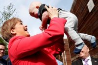 Scotland's First Minister Nicola Sturgeon holds a baby at the launch of the Scottish Nationalist Party Council manifesto at the Whale Arts center in Edinburgh, Scotland, on April 21. (Russell Cheyne/Reuters)