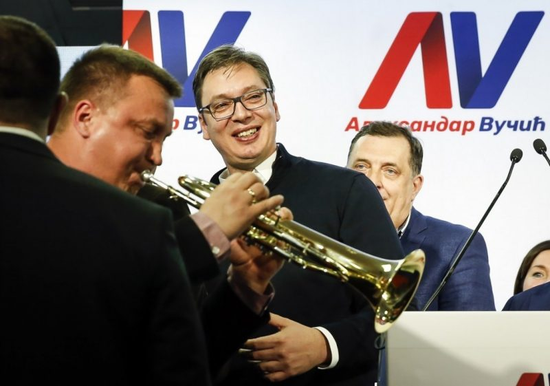 Presidential candidate and Serbian Prime Minister Aleksandar Vucic, center, celebrates his victory on Sunday, in Belgrade, Serbia. Vucic claimed nearly 55 percent of the vote, above the 50 percent threshold required to win in the first round. (Srdjan Stevanovic/Getty Images)