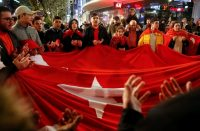 Turks gathered in Berlin on April 16 after hearing the outcome of Turkey's referendum on the constitution. Credit Fabrizio Bensch/Reuters