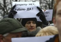 """A woman holds a placard reading """"No to decree, yes to work!"""" in the town of Bobruisk in Belarus on March 12 2017. Vasily Fedosenko/Reuters"""