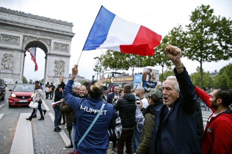 Parisians celebrate on the Champs Elysees on May 7, 2017, following the announcement that Emmanuel Macron would claim victory in France's presidential runoff election. On Sunday, Macron defeated far-right rival Marine Le Pen after a deeply divisive campaign, claiming 66 percent of the final vote. (Geoffroy Van der Hasselt/AFP/Getty Images)