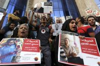 People hold posters of detainees as they protest a law restricting demonstrations as well as the crackdown on activists, in front of the Press Syndicate building in Cairo in 2014. (Mohamed Abd El Ghany/Reuters)
