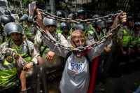 Demonstrators are blocked by Bolivarian National Police agents during a demonstration in Caracas, Venezuela, May 12, 2017. (EPA/MIGUEL GUTIERREZ)