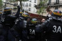 The police and protesters clashed during a demonstration called by labor unions in Paris on Monday. Credit Thibault Camus / Associated Press
