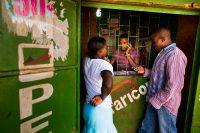 Using M-Pesa services at a store in Nairobi, Kenya. Credit Trevor Snapp/Bloomberg