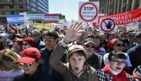 Demonstrating this month in Moscow against the city's plan to knock down Soviet-era apartment blocks and redevelop the neighborhoods. Credit Alexander Nemenov/Agence France-Presse — Getty Images