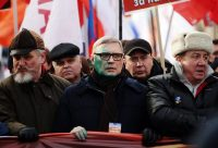Unidentified people threw zelyonka into the face of Mikhail Kasyanov, center, chairman of the People's Freedom Party. Credit Sergei Fadeichev/TASS (Photo by Sergei Fadeichev\TASS, via Getty Images