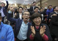 Supporters of South Korean President-elect Moon Jae-in watch closely in Seoul on May 9 as exit polls forecast a win by the Democratic candidate in an election to succeed ousted president Park Geun-hye. (Lee Jin-man/AP)