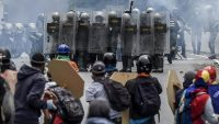 Opposition activists and riot police clash during a protest against Venezuelan President Nicolas Maduro, in Caracas on May 3, 2017. JUAN BARRETO / AFP