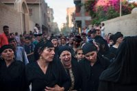 Relatives mourn during the funeral of victims killed in an attack on Coptic Christians in Minya Province, central Egypt on Friday. They were on a bus en route to a monastery when gunmen opened fire on them, killing at least 20 and injuring dozens. Credit Mohamed Hossam/European Pressphoto Agency