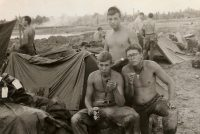 Butch Eakins, standing, with Ronnie Bryan, seated on left, and the author in Vietnam.