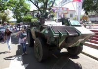 Filipino residents walk past an armored personnel carrier after President Rodrigo Duterte's declaration of martial law in Davao City, Mindanao Island, southern Philippines, on May 24. (Cerilo Ebrano/EPA)